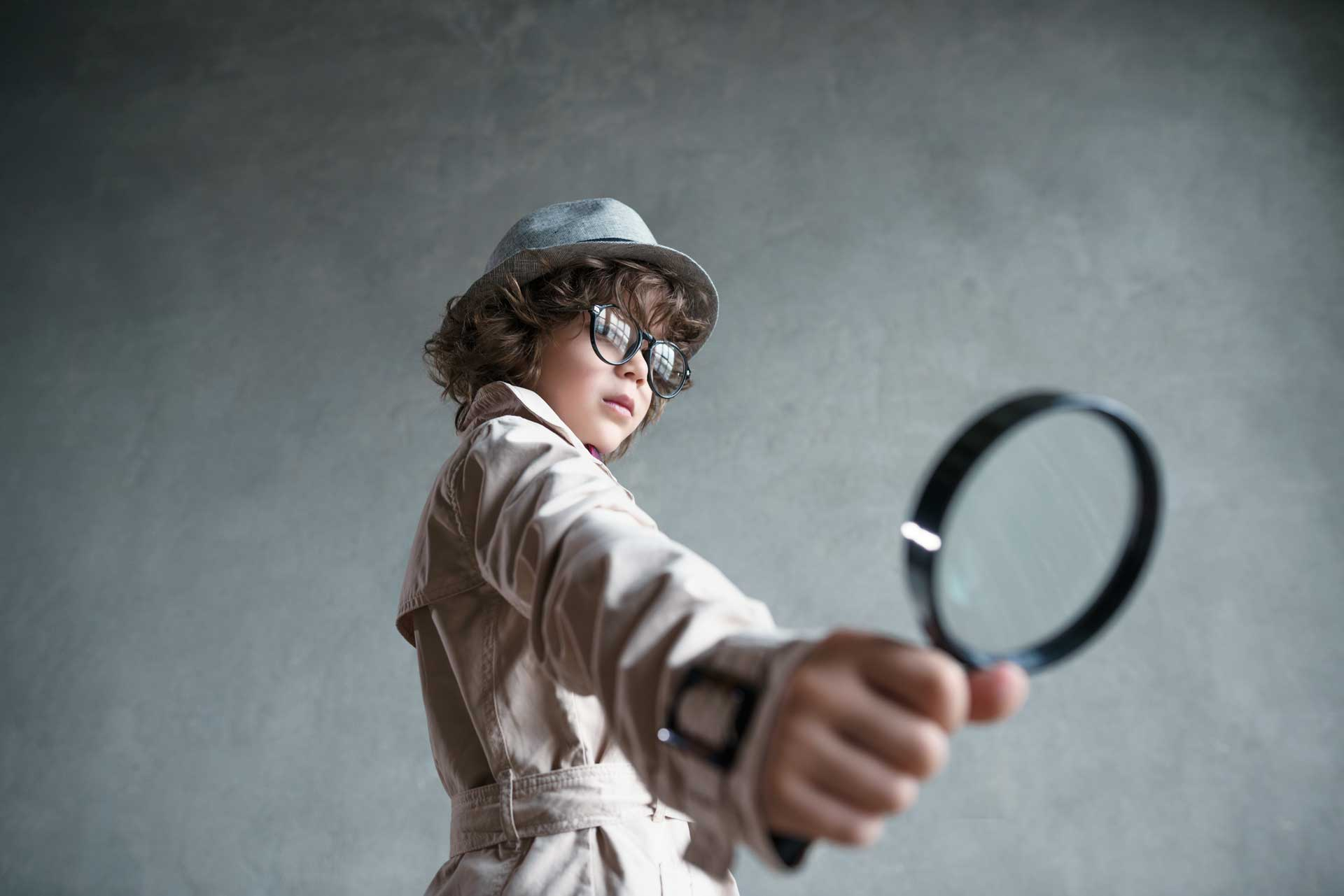 boy detective with magnifying glass